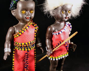 Vintage 1968 7 inch Souvenir Travel dolls from Africa.  Boy and Girl dressed in tribal clothing.  Plastic jointed at shoulders.