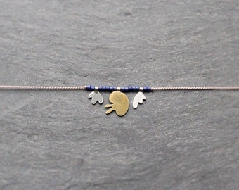 matisse necklace no.3 / sterling silver and brass on silk / hand-cut, one of a kind charm necklace / limited edition