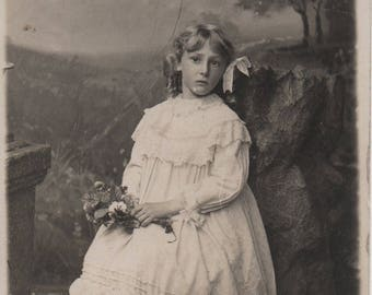 Bonny girl, blonde hair, Edwardian girl, sausage curls, white frill dress, full length portrait, social history, vernacular  (rppc/ch474)