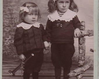 Adorable boys, CDV photo, Carte de Visite,  brothers, toy bugle, French, c1900s, Victorian photo, Victorian child, Social History (cdv/ch6)