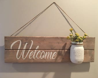 Welcome sign with mason jar