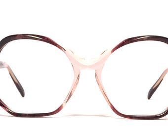 Vintage eyewear.Made in Italy. 1970's. Color  Gem Ruby. Excellent quality and condition! Silver inlay on temples. Mod Hipster Indie