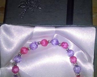 A handmade pink and lilac bracelet
