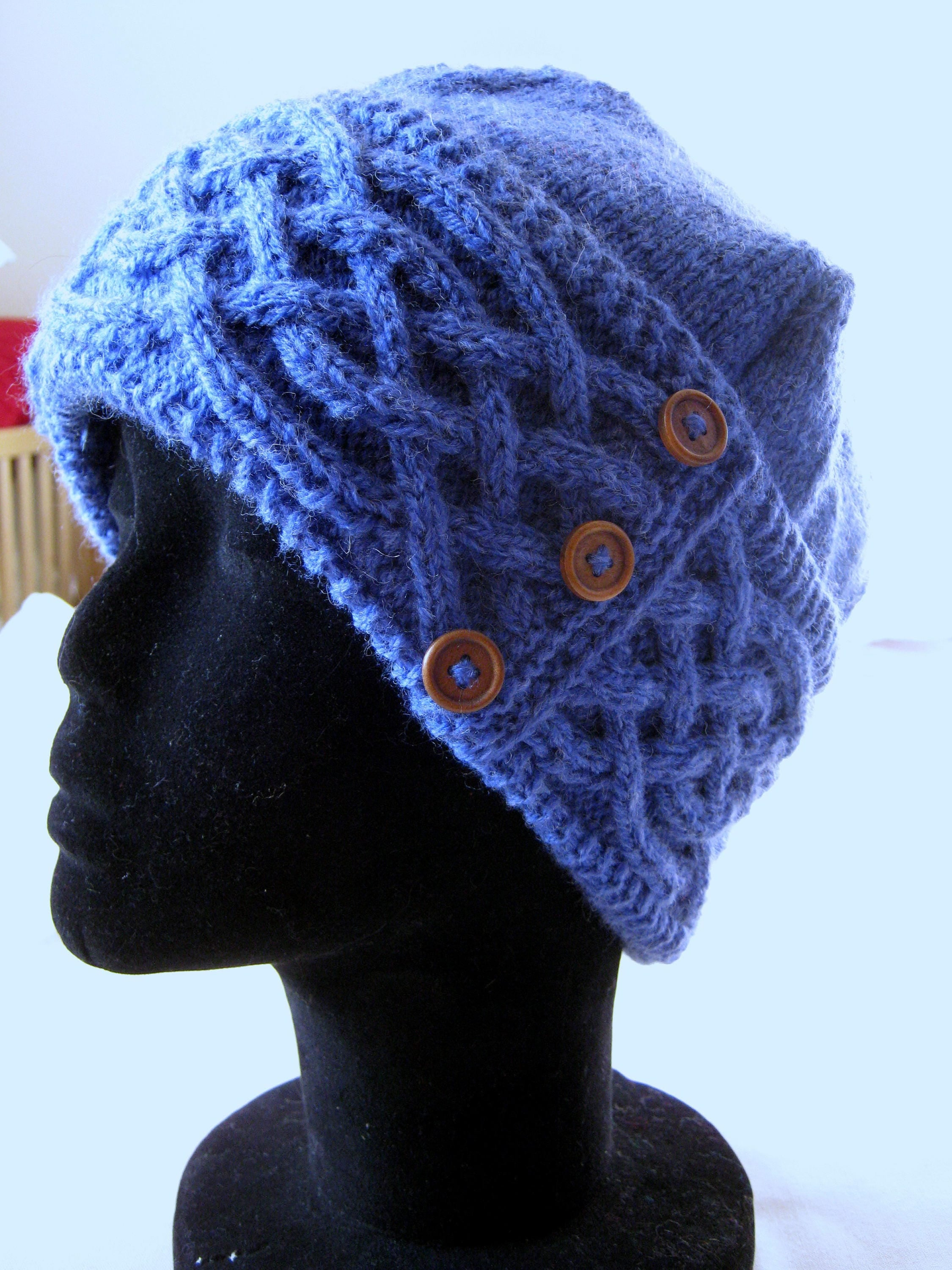 0bf58a457b5 Hand knitted hyacinth blue Saxon Braid pattern Celtic cable hat with wood  button trim - women s