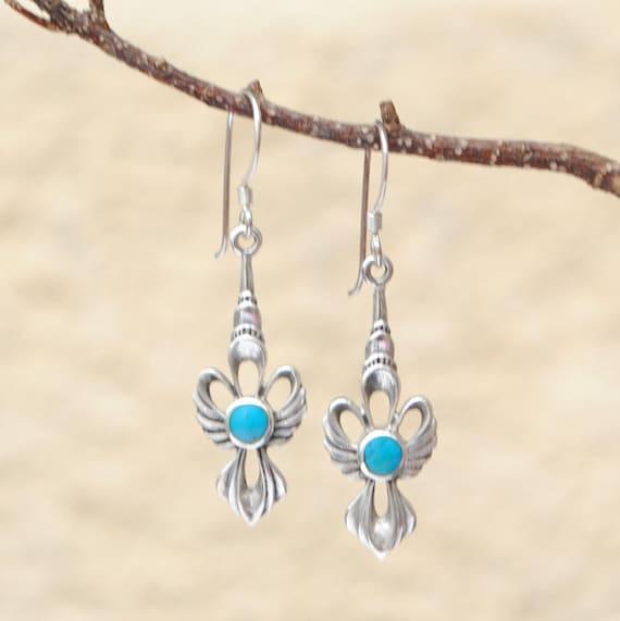 Boucles d'oreilles noeud en turquoise et argent ?