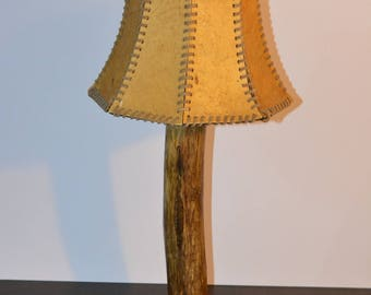 Table lamp from a branch with leather umbrella