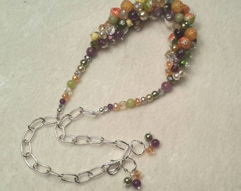 "Amethyst and Jade Fall Colored, Multi Beaded 19"" Necklace and Earring Set that would be a stunning addition to any garmet."