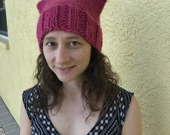 warm chunky knit raspberry wool pussy hat : all proceeds to Planned Parenthood