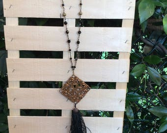 Black and bronze necklace.