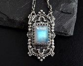 Gothic Moonstone Necklace: Sterling and Fine Silver, natural blue flash rainbow moonstone, fancy twisted long and short chain, PMC art clay