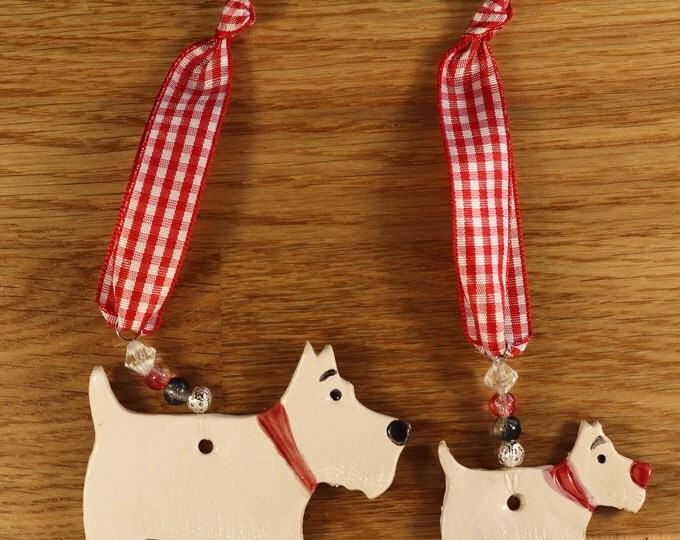 Featured listing image: Two lovely White Westie Terriers Dogs with red collars. Handmade Pottery sent to you in a lovely gossamer bag ready to be given as a gift.