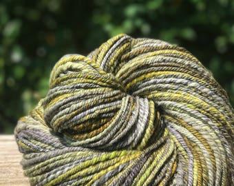 Handspun yarn, green, grey, charcoal, gold, and olive tones, 100% merino wool, malabrigo wool, dk weight, sport weight, three pl