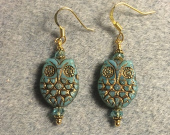 Aqua blue with gold wash Czech glass owl bead earrings adorned with aqua Chinese crystal beads.