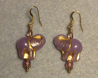 Violet and gold Czech glass elephant bead earrings adorned with violet Czech glass beads.