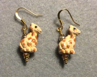 Small tan and orange spotted ceramic giraffe bead earrings adorned with tan Chinese crystal beads.