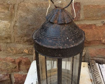 This is a beautiful old black metal 19th Century Shepherd's Lantern.