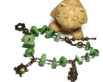 Bohemian bracelet, charms, Green Pearl and beads bronze overlap