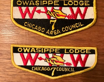 Vintage Boy Scout flap patches from early 1960s Owasippe Lodge Chicago Area 7 Council. One patch has finger nails the other does not. Unused