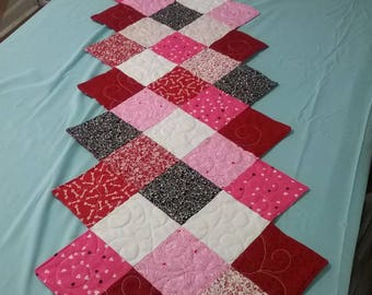 "Valentine's Day zigzag quilted table runner with reversible design, size 18"" by 54"""