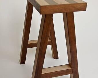 Small bench in alder with walnut trim