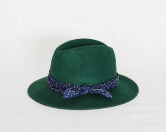 Forest green fedora hat decorated with a cotton scarf
