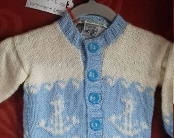 Hand knitted cardigan to fit a child aged 3-6 months old