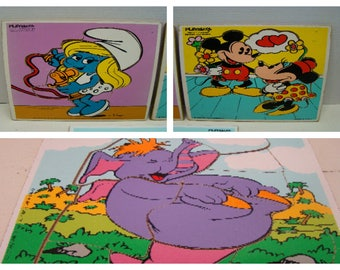 3 Playskool wooden tray puzzles. Smurfette, Mickey & Minnie, plus Eleroo (Disney). Nice condition, some edge wear (see pic 4), but complete