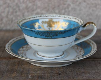 Vintage Occupied Japan Tea Cup And Saucer Ucagco China Baby Blue & Gold Filigree