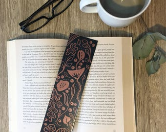 Hand illustrated metallic rose gold floral designed bookmark, with laminated gloss coating.