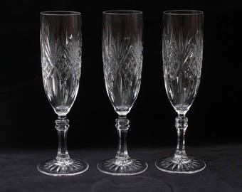 Three vintage crystal champagne flutes or glasses  8.125 inches   Excellent