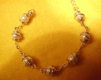 Bracelet white pearls, clear silver colored metal bead cages