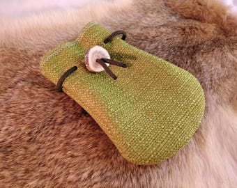 Small green fabric pouch, with olive green drawstring and an antler button