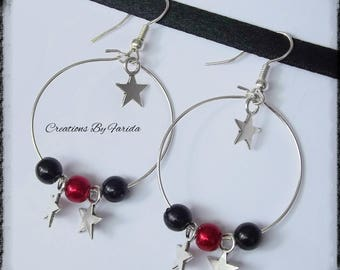 Hoop earrings with black and red beads interspersed with stars