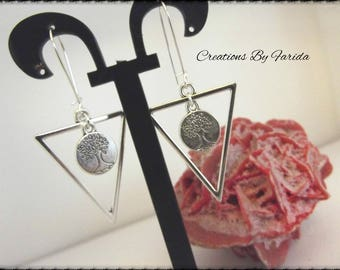 Earrings with a silver metal inverted triangle and a small charm with a tree top