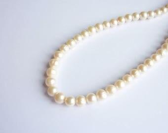Salmon light 7-8mm cultured pearl has P0150 unit