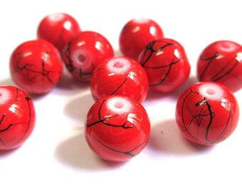 14 red, black round beads 10mm painted glass