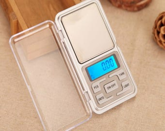 1 small scale 0.1 g to 500 g electronic pocket, digital