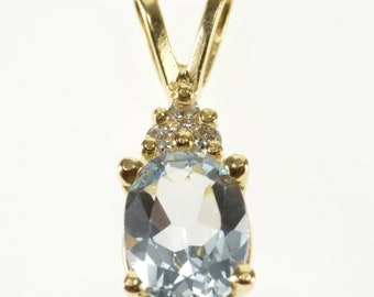14k Blue Topaz Oval Diamond Cluster Accented Pendant Gold