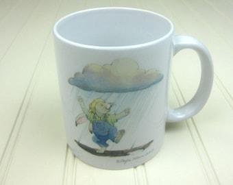 Bunny dancing in the rain 11 oz coffee mug