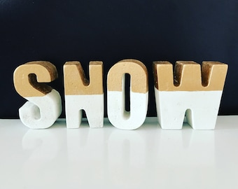 Snow concrete letters topped with gold!