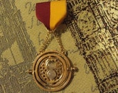 Harry Potter Hermione Granger Time Turner Gryffindor House Pride Medal with Full, Moveable Time-Turner Pendant w/ working Hourglass, Script