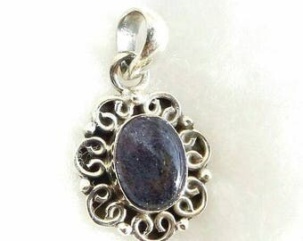 A beautiful labrdorite stone pendant  sterling silver 925 .