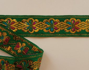 Large green and gold trim, flowers and diamonds