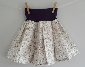 The skirt that turns! White/purple