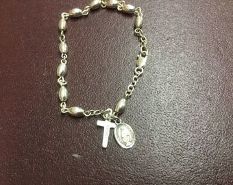 Sterling silver bracelet with a cross and the miraculous Mary pendent