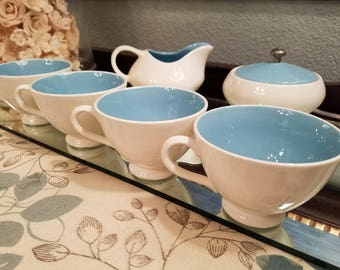 Vintage 1960s blue and white 7 pc coffee set with 4 cups, creamer, and lidded sugar bowl. Classic style and beautiful color!