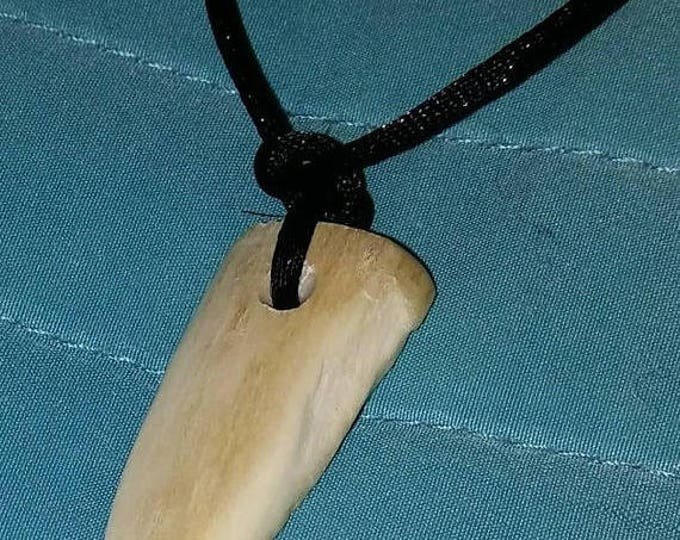 Hand carved Wolf tooth pendants