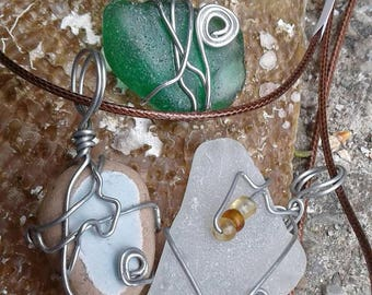 Necklaces with stones, polished glass, shells and tiles.