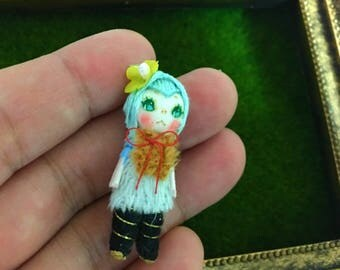 Miniature cloth doll (robin)