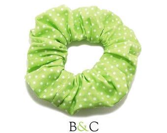 Green white polka dot hair scrunchie.